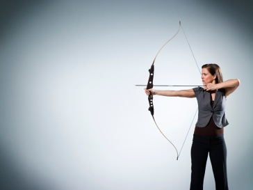 Businesswoman Taking Aim --- Image by © Nice One Productions/Corbis