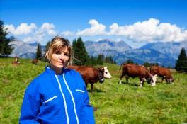 beautiful woman farmer in alpine mountain, France